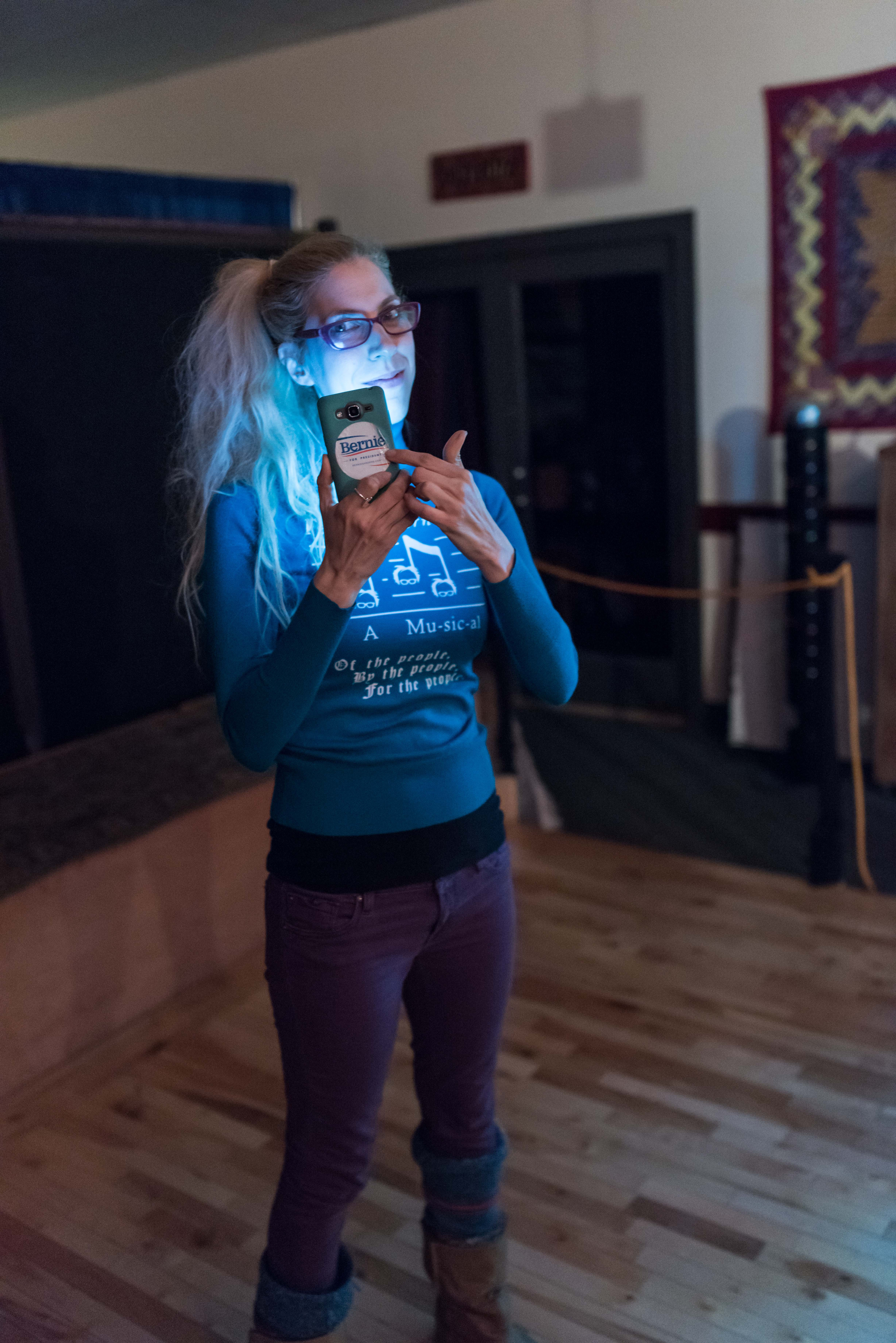 Meira Marom, before the start of the play, showing off the Bernie bumper sticker on her phone